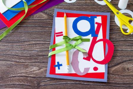 Greeting card with a pencil and letters for the new school year. Welcome back to school. Childrens Art Project, needlework, crafts for kids. Copy space.