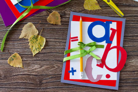 Greeting card with a pencil and letters for the new school year. Welcome back to school. Childrens Art Project, needlework, crafts for kids. Top view with copy space.