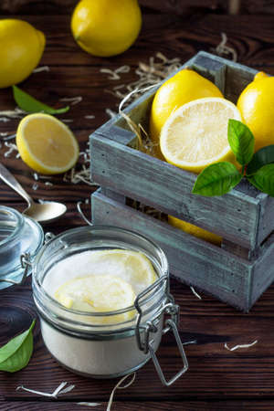 Slices of fresh lemon in sugar and fresh lemons on the kitchen table. The concept of healthy nutrition and diet.