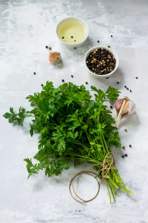 Fresh parsley on a light stone or slate background. Flat lay. Top view with copy space. Stock Photo