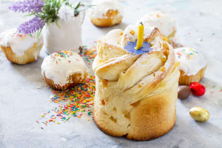 Traditional food on the holiday table Kruffin- bread cake with   candied fruits and easter eggs. Easter recipe.