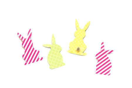 Festive decor of handmade - Easter bunny (Easter rabbit)craft of paper, isolated on white background.