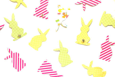 Easter bunny (Easter rabbit) craft of paper, isolated on white background. Festive decor of handmade. Pattern.