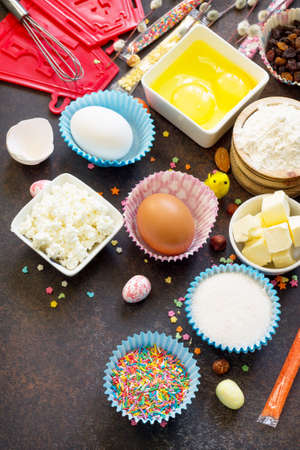 Ingredients for Easter baking - cottage cheese, nuts, eggs, flour, yeast, butter, raisins and sugar.