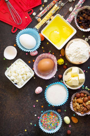 Ingredients for Easter baking - cottage cheese, nuts, eggs, flour, yeast, butter, raisins and sugar. Flat lay. Top view with copy space.