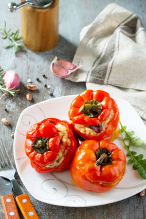 Stuffed Pepper with Rice, Tomatoes and Beans on a stone or concrete background. Vegetarian Healthy Food.