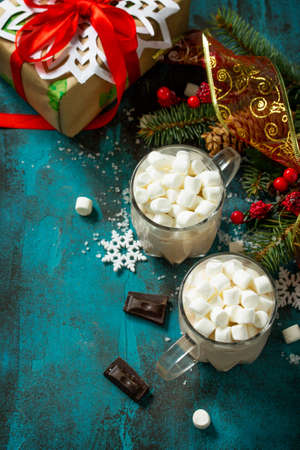 Hot Chocolate with Marshmallows and Christmas Gift on a blue stone or concrete table. Copy space. 版權商用圖片