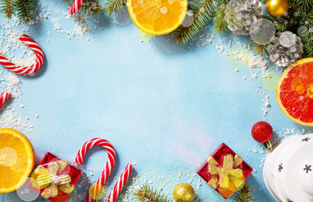 Christmas festive background with lantern and gifts on a blue stone background. Top view flat lay background. Copy space.