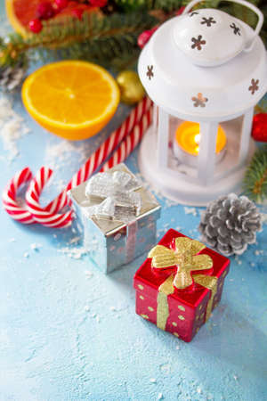 Christmas festive background with lantern and gifts on a blue stone background. Copy space. Stock Photo