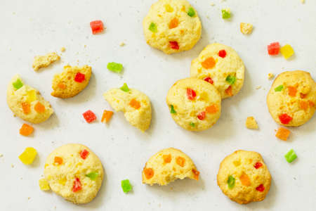 Cookies bar. Homemade cookies with candied fruit, isolate on a light stone table. Top view flat lay background.