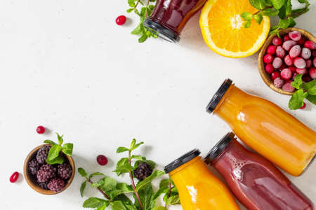 Healthy Juicy Vitamin Drink Diet or Vegan Food Concept, fresh fruit and berry. Delicious Array of fresh Fruit Juices. Top view flat lay background. Copy space.