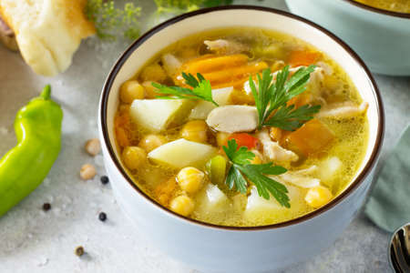 Homemade Hot Soup with Vegetables, Chicken and Peas Chickpeas. Eastern cuisine. The concept of healthy eating.