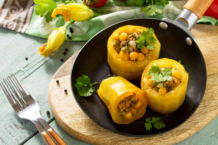 Healthy food: Baked Zucchini Stuffed - with chickpea and Meat on kitchen table. Diet menu. Stock Photo