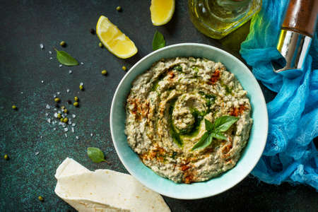Homemade delicious and healthy protein vegan, vegetarian food, Ramadan food. Hummus with mung and tahini. Top view flat lay. Free space for your text.
