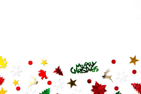 Christmas or new year composition. Christmas confetti isolated on a white background. Top view.