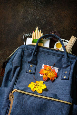 Back to school concept. School supplies with blue backpack on table. Top view flat lay. Free space for your text.