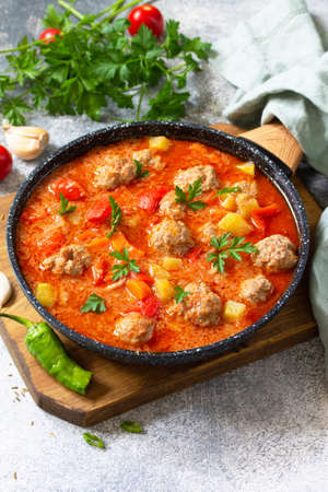 Spanish and Mexican food - Albondigas. Hot stew tomato soup with meatballs and vegetables. Free space for your text.