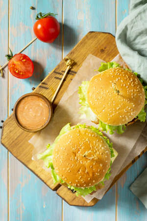 American snack Street food. Fast food. Homemade hamburger on wooden rustic table. Top view.   Stock Photo