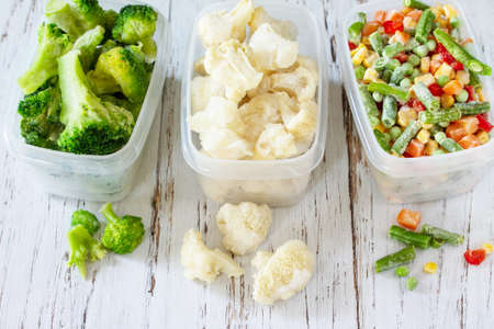 Healthy food is frozen. Stocks of food for the winter. Containers with frozen vegetables.