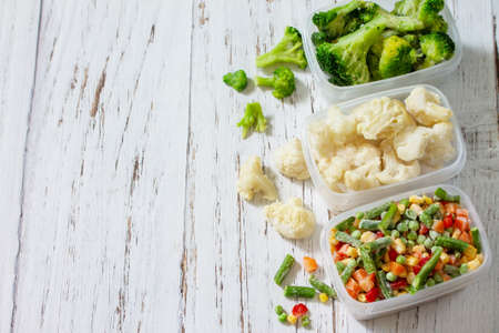 Healthy food is frozen. Stocks of food for the winter. Containers with frozen vegetables. Copy space.