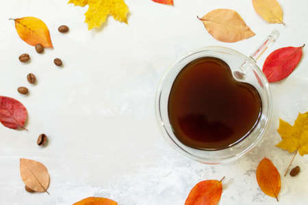 Autumnal concept with mup of Cup of hot coffee. Flat lay top view. Free space for your text.