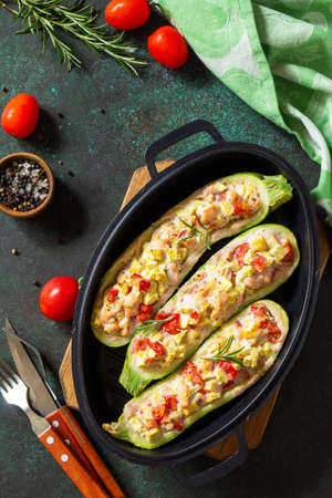 Healthy food. Baked zucchini stuffed with meat and tomatoes in a cast iron pan. Top view flat lay background.