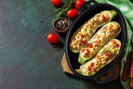 Healthy food. Baked zucchini stuffed with meat and tomatoes in a cast-iron pan. Copy space.