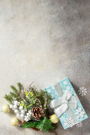 Xmas background. Christmas presents gift blue box and tree branch decor. Top view flat lay background. Copy space.