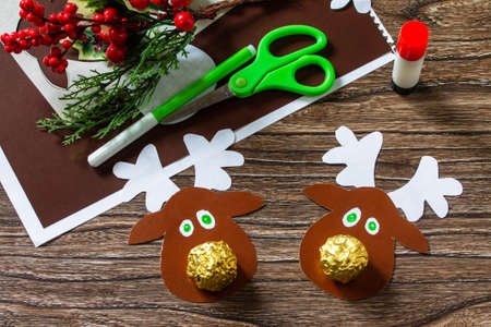 Funny Gift with candy Christmas deer. Handmade. Children's creativity project, crafts, crafts for kids.