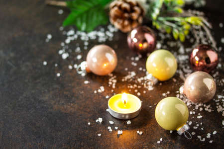 Christmas composition. Christmas glossy ball and a candle.