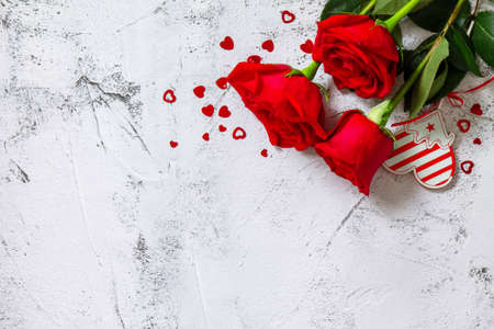 Valentine's Day Concept. Red roses and heart decor on Ultimate Gray background. Space for text or design.