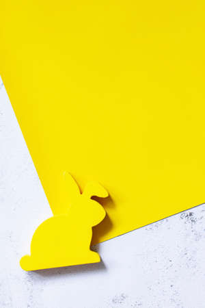 Minimal Easter concept. Yellow bunny on Illuminating Yellow and Ultimate Gray Color of the year 2021. Top view flat lay background. Copy space.
