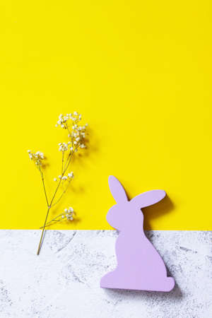 Minimal Easter concept. Purple bunny on Illuminating Yellow and Ultimate Gray Color of the year 2021. Top view flat lay background. Copy space.