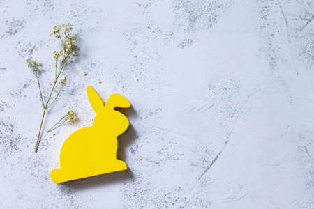 Minimal Easter concept. Yellow bunny on Ultimate Gray Color of the year 2021. Top view flat lay background. Copy space.