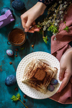 Easter background. Dessert tiramisu Easter cottage cheese pascha on festive table. Top view flat lay.