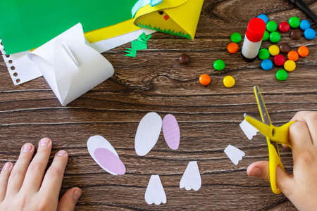 Instruction, step 8. Making the Paper box for packing sweets with Easter bunny and Easter chick. Handmade. Project of children's creativity, handicrafts, crafts for kids. Stock fotó