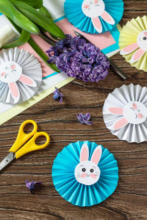 Children's paper decor. Funny paper easter bunny. Easter handmade Project of children's creativity, handicrafts, crafts for kids.