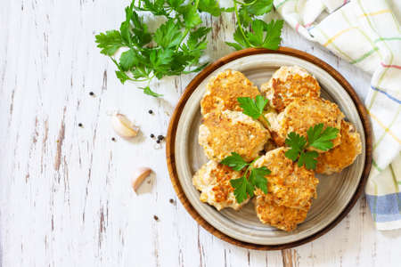 Healthy vegan food. Tasty homemade Red fish cutlets on a wooden rustic table. Top view, flat lay background. Copy space. 免版税图像