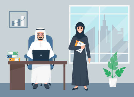 Arab business man and woman working in office.