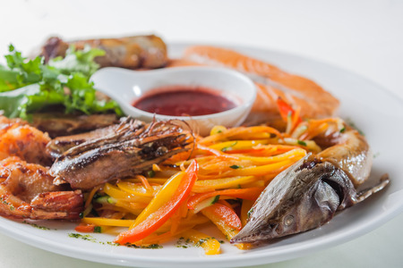 sturgeon: Assorted seafood with herbs, spices and vegetables