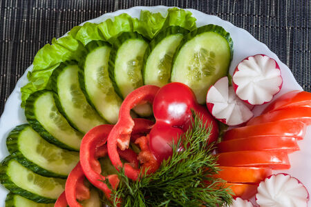 Assorted vegetables. radish, tomatoes, cucumbers, peppers photo
