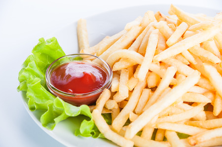 collation: French fries with ketchup and lettuce on a white background Stock Photo