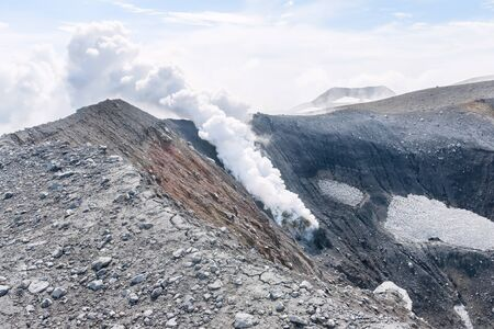 volcano slope: A pillar of gas on the slope of the volcano Tolbachik on Kamchatka