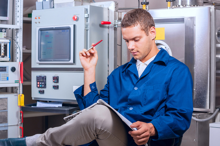 wrote: Engineer wrote the experimental results on the vacuum system Stock Photo