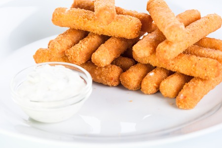 Crispy cheese sticks deep-fried on a white background.