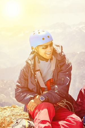Close up portrait of smiling mountaineer in helmet on high mountain, Fann, Pamir Alay, Tajikistan Stock Photo