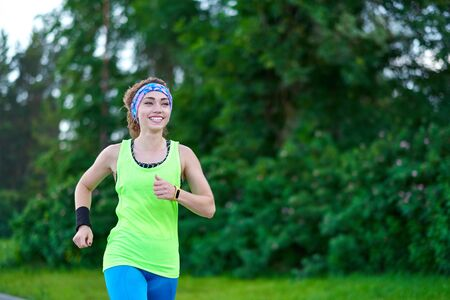 Running woman. Female Runner Jogging during Outdoor Workout in a Park. Beautiful fit Girl. Fitness model outdoors. Weight Loss. Reklamní fotografie - 125340268