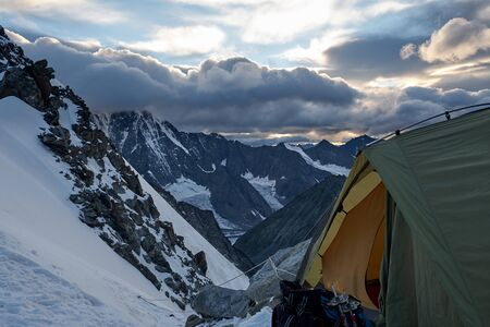 camping tent on top of mountain. Altai, Belukha district.