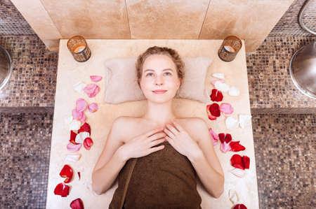 happy woman in hammam or turkish bath in relax.