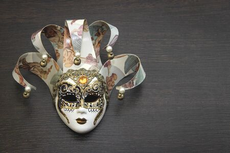 The mask is a souvenir from Venice. Stock Photo